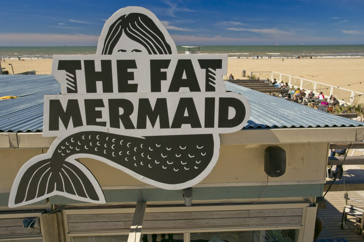 The Fat Mermaid logo on roof